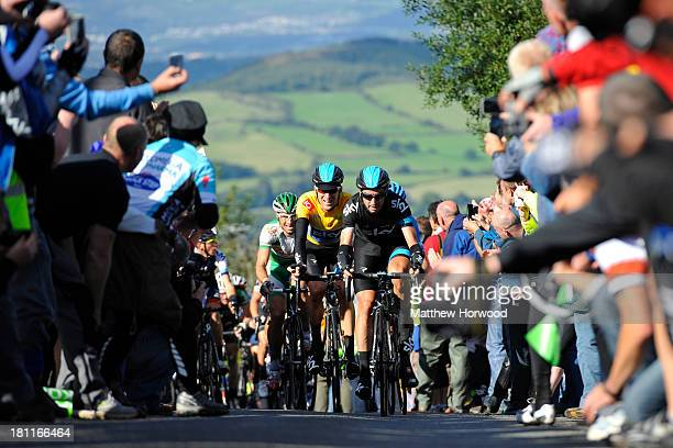 Sir Bradley Wiggins powers his way up Caerphilly mountain alongside teammate David Lopez during the Tour of Britain Stage 5 from Machynlleth to...