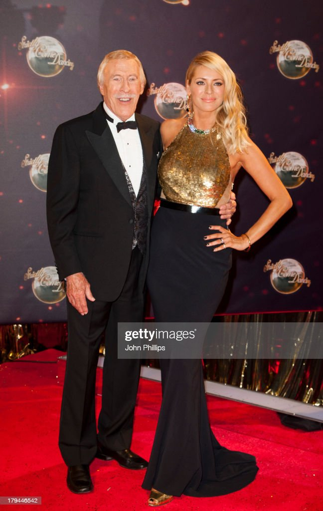 Sir Bruce Forsyth and Tess Daly attend the red carpet launch for 'Strictly Come Dancing' at Elstree Studios on September 3, 2013 in Borehamwood, England.