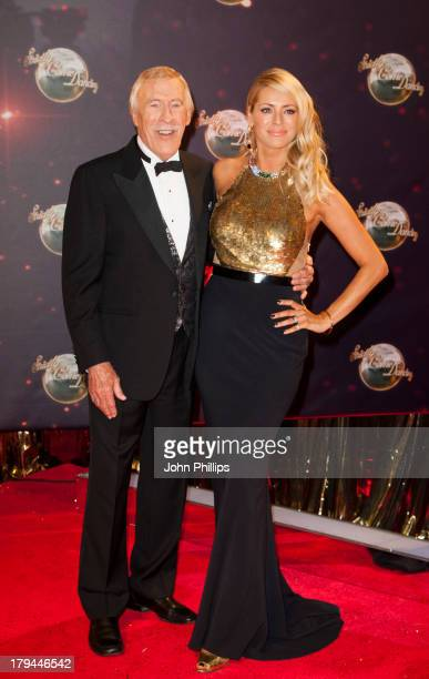 Sir Bruce Forsyth and Tess Daly attend the red carpet launch for Strictly Come Dancing at Elstree Studios on September 3 2013 in Borehamwood England