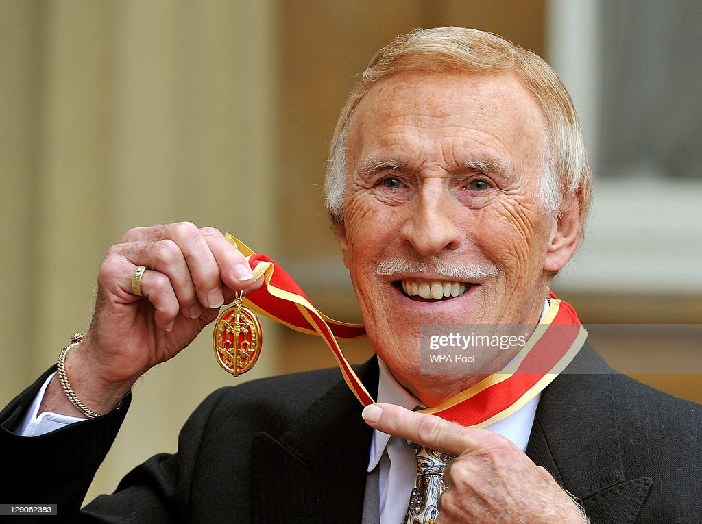 Sir Bruce Forsyth poses after he was knighted by Queen Elizabeth II at Buckingham Palace on October 12, 2011 in London, England. The Strictly Come Dancing host's place as a leading TV presenter is recognised after years of campaigning by fans.