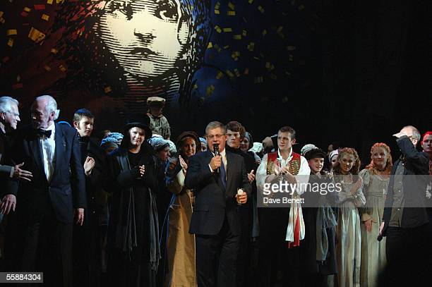 Sir Cameron Mackintosh and the cast on stage at the 20th Anniversary Celebration of Les Miserables show at the Queens Theatre on October 8 2005 in...