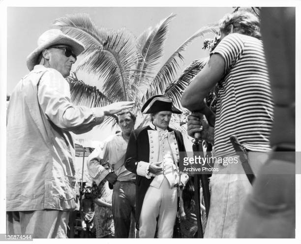 Sir Carol Reed directing Richard Harris Trevor Howard and other actors for important scene in the from the film 'Mutiny On The Bounty' 1962