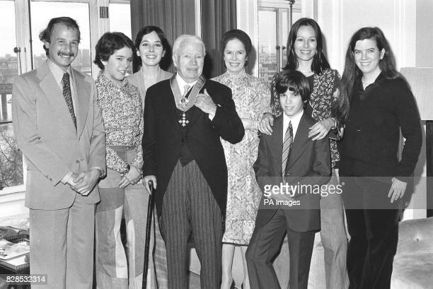 Sir Charlie Chaplin is back in his suite at the Savoy Hotel after being knighted at the Palace with his family Behind him His soninlaw Nick...