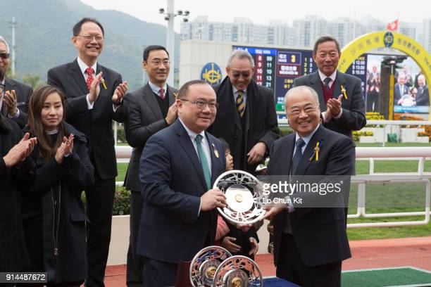 Sir Chow Chungkong Steward of the HKJC presents the Centenary Vase silver dish to Edmond Siu Kim Ping at Sha Tin racecourse on February 4 2018 in...