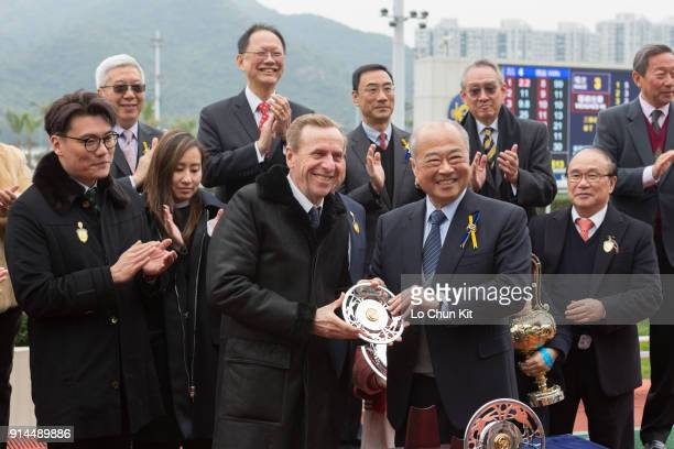 Sir Chow Chungkong Steward of the HKJC presents the Centenary Vase silver dish to winning trainer John Size at Sha Tin racecourse on February 4 2018...
