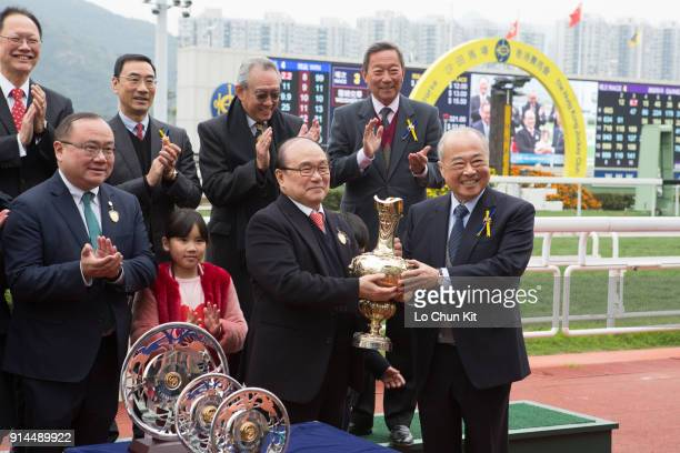 Sir Chow Chungkong Steward of the HKJC presents the Centenary Vase trophy to Dinozzo's Owner Siu Pak Kwan at Sha Tin racecourse on February 4 2018 in...