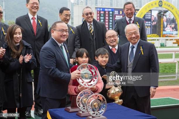 Sir Chow Chungkong Steward of the HKJC presents the Centenary Vase trophy and silver dish to Dinozzo's Owner Siu Pak Kwan Edmond Siu Kim Ping at Sha...