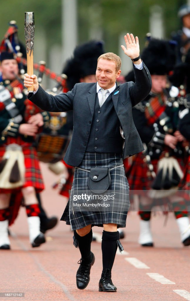 Sir Chris Hoy carries the 2014 Glasgow Commonwealth Games Baton down The Mall during the launch of the Queen's Baton Relay at Buckingham Palace on October 9, 2013 in London, England. Following the launch, the baton relay will continue it's journey visiting all 70 competing nations and territories ahead of the 2014 Glasgow Commonwealth Games.