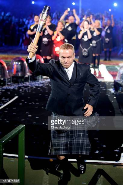 Sir Chris Hoy delivers the baton during the Opening Ceremony for the Glasgow 2014 Commonwealth Games at Celtic Park on July 23 2014 in Glasgow...