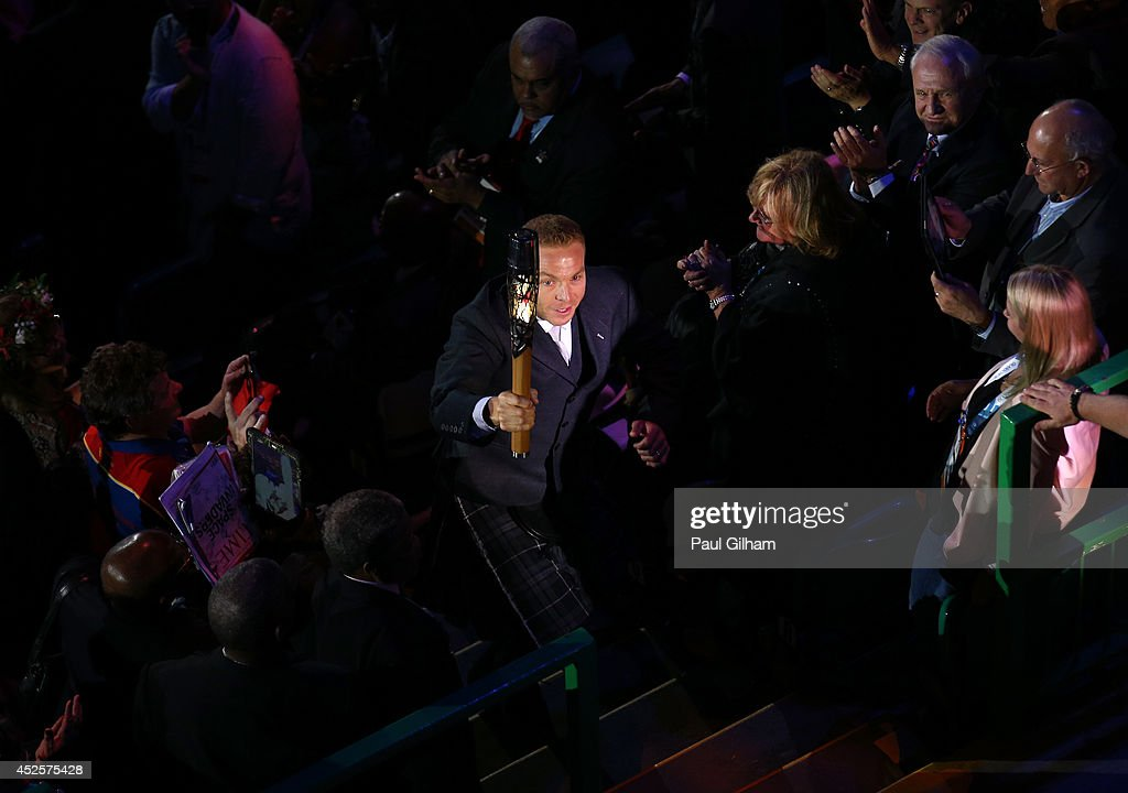 Sir Chris Hoy holds up the baton during the Opening Ceremony for the Glasgow 2014 Commonwealth Games at Celtic Park on July 23, 2014 in Glasgow, Scotland.