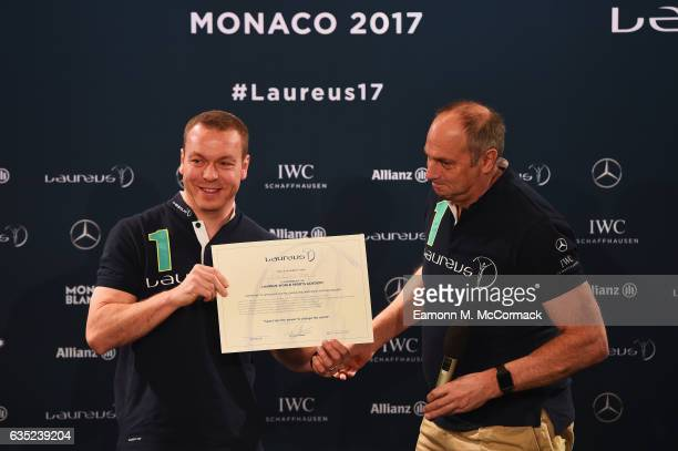 Sir Chris Hoy is presented with his Laureus Academy Member certificate by Laureus Academy member Sir Steve Redgrave at a press conference prior to...