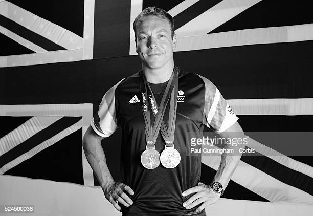 Sir Chris Hoy national flag bearer and double gold medalist cycling champion of the 2012 London Olympic's poses with two gold medals making him the...