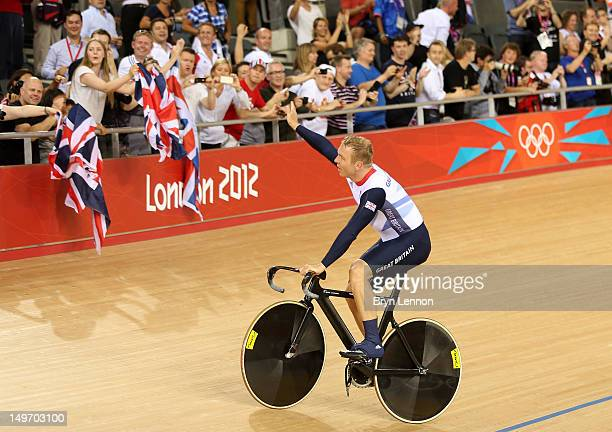 Sir Chris Hoy of Great Britain celebrates after setting a new world record and winning gold in the Men's Team Sprint Track Cycling final on Day 6 of...