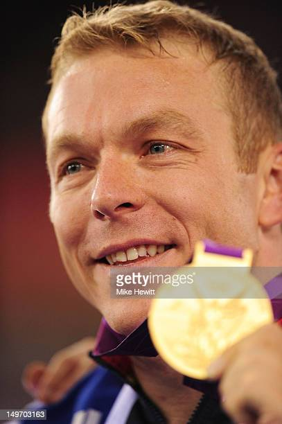 Sir Chris Hoy of Great Britain poses with his gold medal during the medal ceremony after setting a new world record in the Men's Team Sprint Track...