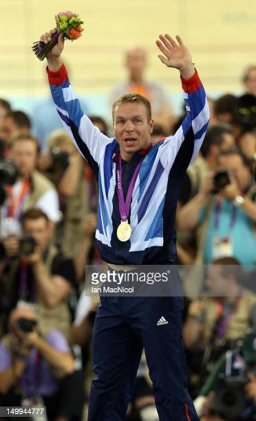 Sir Chris Hoy of Great Britain stands on the podium with the gold medal he won in final of the men's Keirin during Day 11 of the London 2012 London...