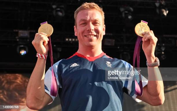 Sir Chris Hoy who won gold in the team sprint and the keirin at the London 2012 Olympics greets the crowd during BT London Live at Hyde Park on...