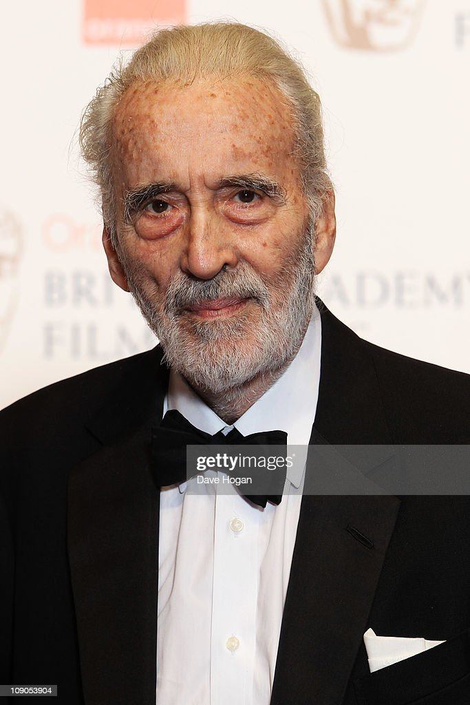 Sir Christopher Lee poses in front of the winners boards at the Orange British Academy Film Awards 2011 held at The Royal Opera House on February 13, 2011 in London, England.