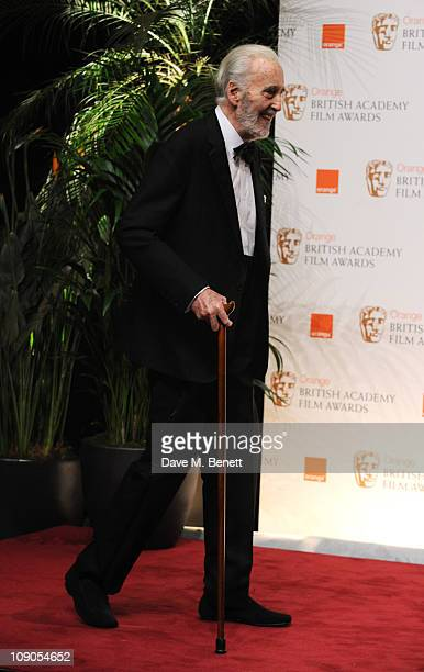 Sir Christopher Lee poses with the Academy Fellowship Award during the Orange British Academy Film Awards 2011 at The Royal Opera House on February...