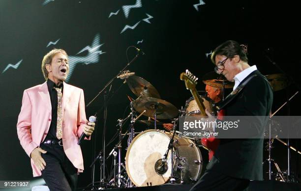 Sir Cliff Richard and Hank Marvin of The Shadows performs live on stage at the O2 Arena on September 28 2009 in London England