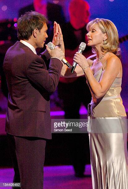 Sir Cliff Richard and Olivia NewtonJohn during The Royal Variety Concert Inside and Show at The London Coliseum in London England Great Britain