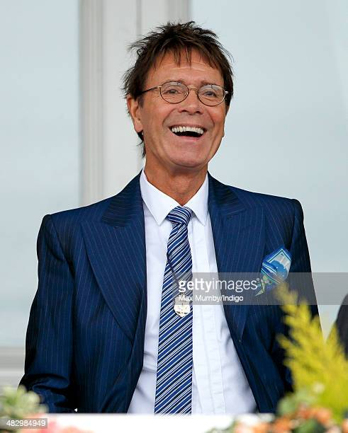 Sir Cliff Richard attends the Crabbie's Grand National horse racing meet at Aintree Racecourse on April 5 2014 in Liverpool England