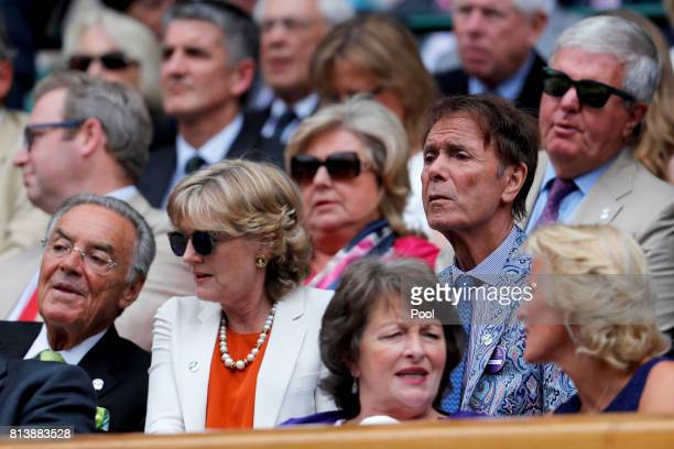 Sir Cliff Richard looks on from the centre court royal box on day ten of the Wimbledon Lawn Tennis Championships at the All England Lawn Tennis and...