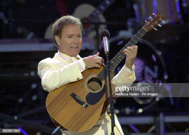 Sir Cliff Richard on stage in the gardens of Buckingham Palace for the second concert to commemorate the Golden Jubilee of Britain's Queen Elizabeth...