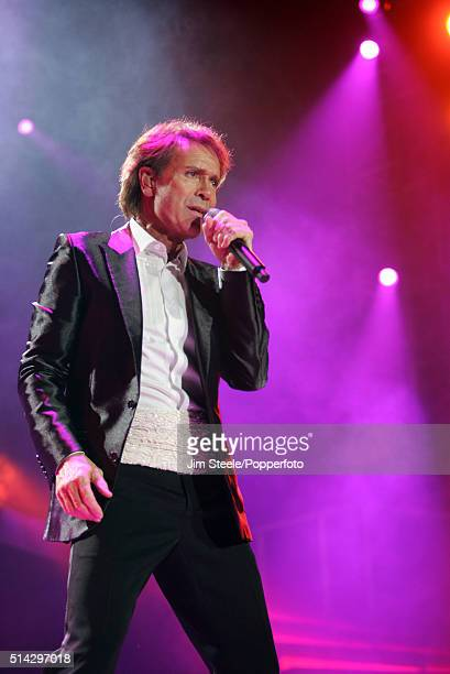 Sir Cliff Richard performing on stage.