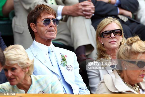 Sir Cliff Richard sits in the Royal Box on day ten of the Wimbledon Lawn Tennis Championships at the All England Lawn Tennis and Croquet Club on July...