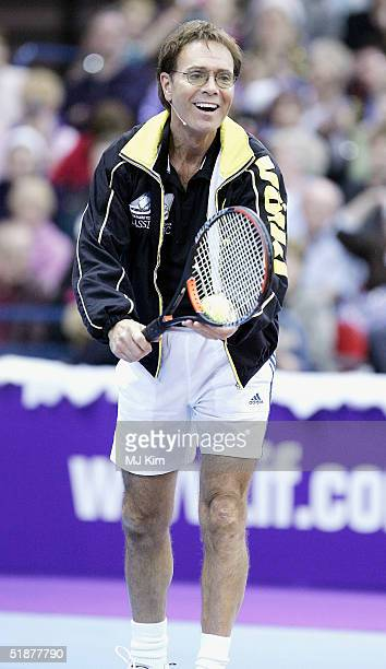 Sir Cliff Richard takes part in the 'Intelligent Finance Cliff Richard Tennis Classic' at Birmingham National Indoor Arena on December 18 2004 in...