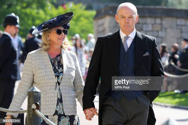 Sir Clive Woodward and Jayne Williams arrive at St George's Chapel at Windsor Castle before the wedding of Prince Harry to Meghan Markle on May 19...
