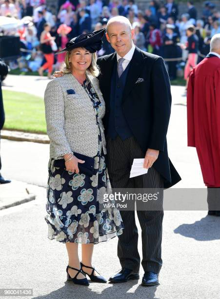 Sir Clive Woodward and Jayne Woodward arrive at St George's Chapel at Windsor Castle before the wedding of Prince Harry to Meghan Markle on May 19...