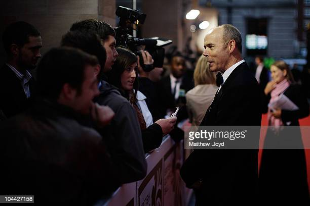 Sir Clive Woodward Director of sport at the British Olympic Association talks to media at the British Olympic Ball at Grosvener House hotel on...