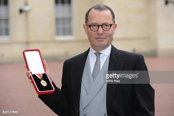 Sir Colin Callender poses after he was made a Knight Bachelor by the Princess Royal during an investiture ceremony at Buckingham Palace on June 22...