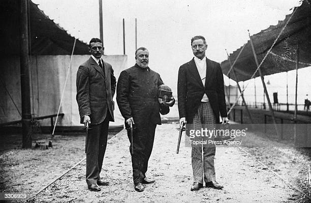 Sir Cosmo Duff Gordon , W. Bean and Captain MacDonnell of the British Fencing Team at the Olympic Games in London. All three hold dueling pistols.