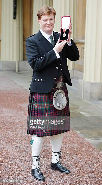 Sir Daniel Alexander holds his insignia of Knighthood which was presented by the Prince of Wales at the Investiture ceremony in Buckingham Palace on...
