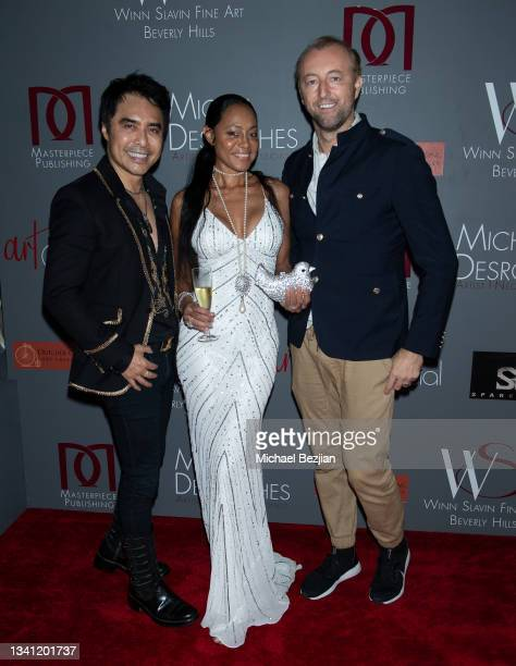 """Sir Daniel Winn, Lady Lisa Faith McNeilly, and Prince Mario Max arrive at Premiere Exhibition Of Master Artist Michel T. Desroches """"The Space Within""""..."""