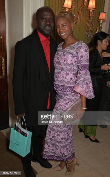 Sir David Adjaye and Tolula Adeyemi attend the British Vogue and Tiffany Co Celebrate Fashion and Film Party at Annabel's on February 10 2019 in...