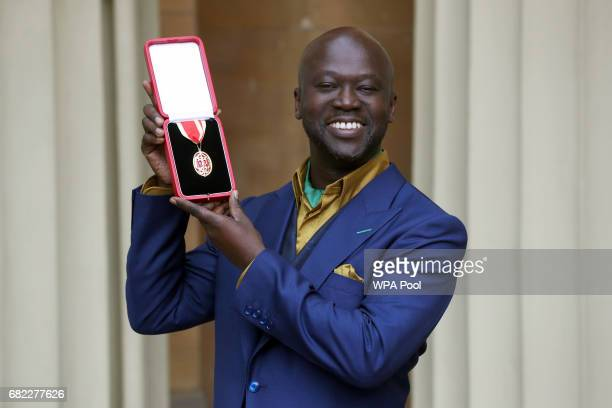 Sir David Adjaye poses after he was Knighted by the Duke of Cambridge during an Investiture ceremony at Buckingham Palace on May 12 2017 in London...