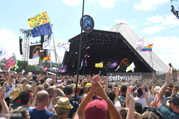 Sir David Attenborough appears on the Pyramid stage during day five of Glastonbury Festival at Worthy Farm, Pilton on June 30, 2019 in Glastonbury,...