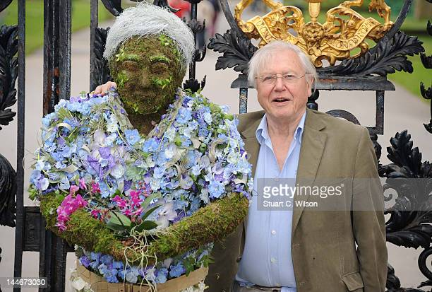 Sir David Attenborough poses with a floral sculpture of himself outside the Royal Botanical Gardens at Kew Gardens on May 17 2012 in London England...