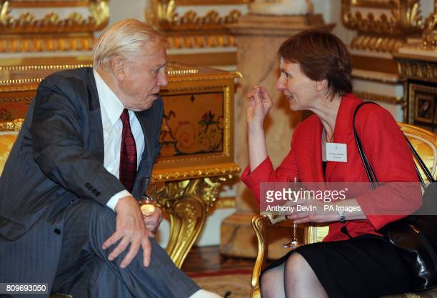Sir David Attenborough speaks with Dr Helen Sharman as the Queen and Duke of Edinburgh host a reception to celebrate exploration and adventure at...