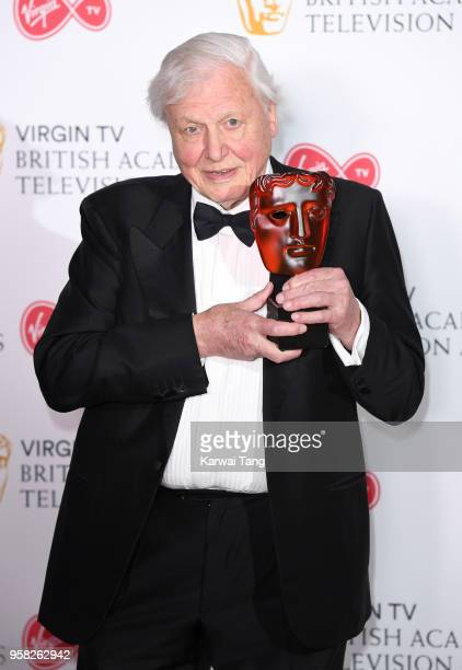 Sir David Attenborough with the award for Virgin TV Must See Moment for 'Blue Planet II' poses in the press room during the Virgin TV British Academy...