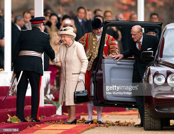 Sir David Brewer LordLieutenant of Greater London greets Queen Elizabeth II and Prince Philip Duke of Edinburgh as they attend the ceremonial welcome...