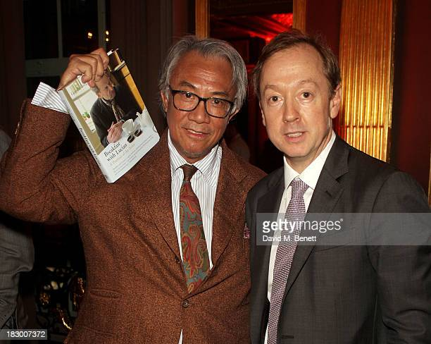 Sir David Tang and Geordie Greig attend the launch of Geordie Greig's new book Breakfast With Lucian on October 3 2013 in London England