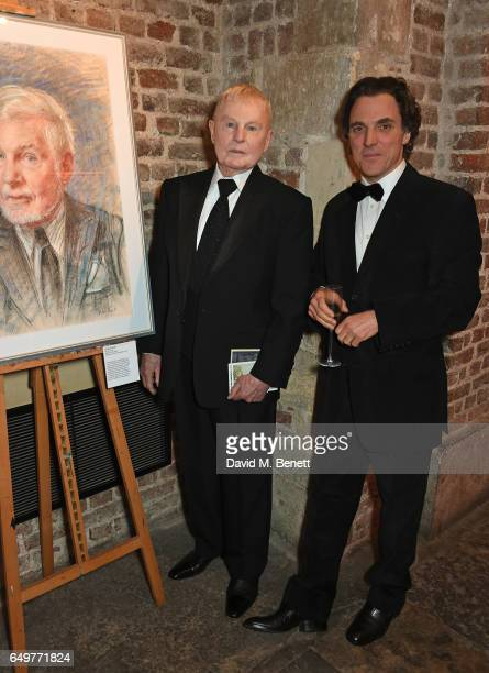 Sir Derek Jacobi and Alexander Newley attend the St MartinintheFields Gala Dinner and auction of Alexander Newley portraits on March 8 2017 in London...