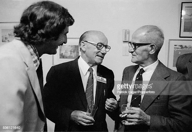Sir Donald Bradman of Australi talking to former England bowler Harold Larwood and Dennis Lillee of Australia during the Centenary Test match between...