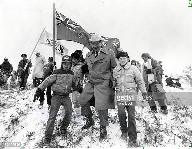 Sir Edmund Hillary climbs a hill with local scouts and children on December 10 1985 near Orangeville The event was part of a local fundraiser