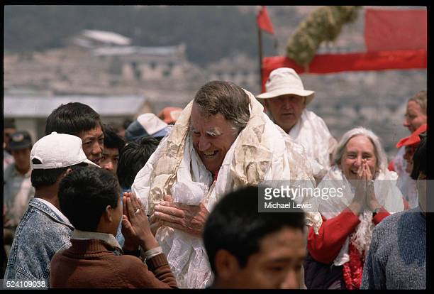 Sir Edmund Hillary is welcomed by students in the town where the Himalayan Trust built their first school and hospital in the Everest region Khumjung...