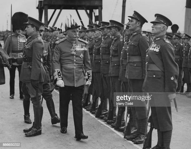 Sir Edward Broadbent inspects a guard of honour on Guernsey before leaving for England at the end of his term as Lieutenant Governor of Guernsey 17th...